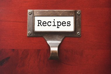 Lustrous Wooden Cabinet with Recipes File Label