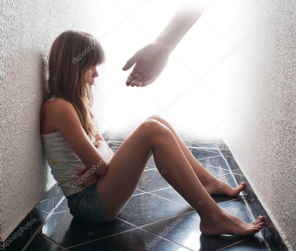 Depressed teenager sitting on the floor