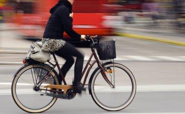 Biker in city traffic
