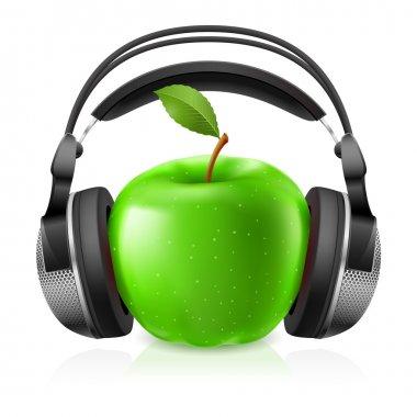 Realistic headphones and green apple