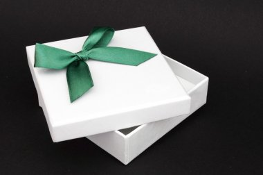 White gift with green ribbon