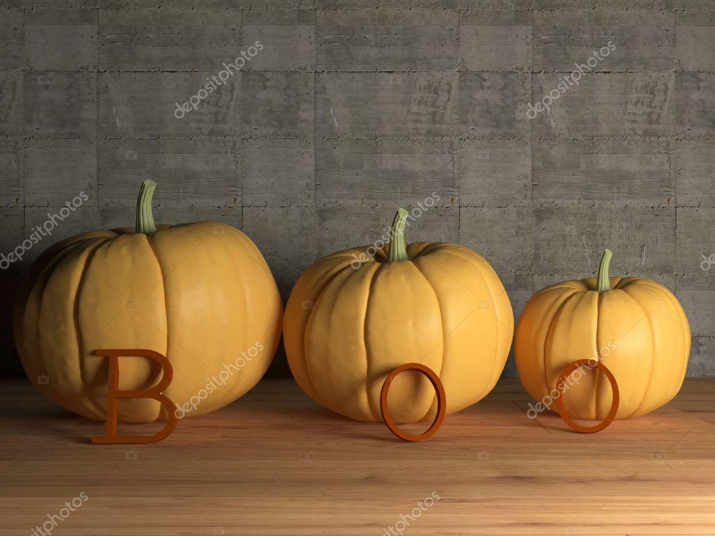 Drie pompoen op tafel met boo letters u stockfoto kosheen