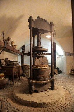 Antique winepress in a cellar stock vector