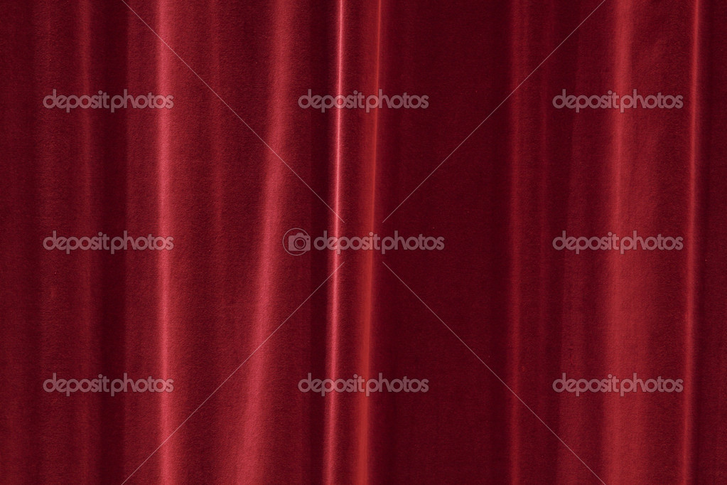 Red background texture that looks like a silky fabric or curtain