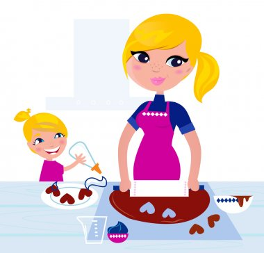 Cute Girl helping her Mother with christmas baking