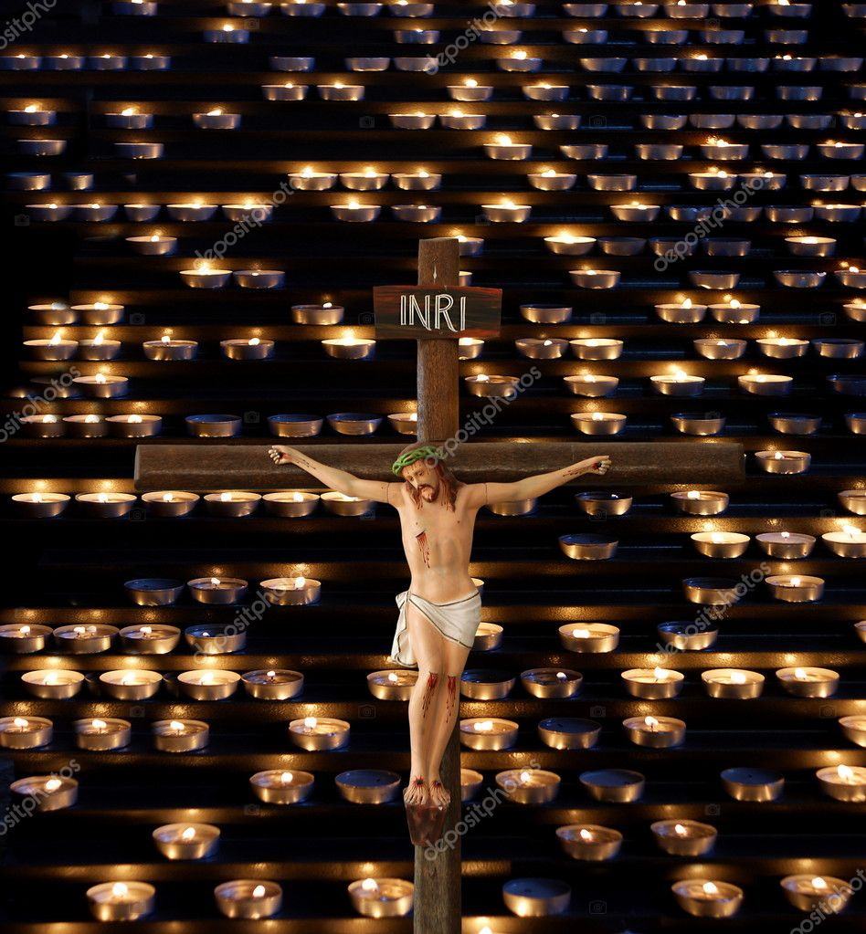 jesus crucifixion against the background of church candles u2014 stock