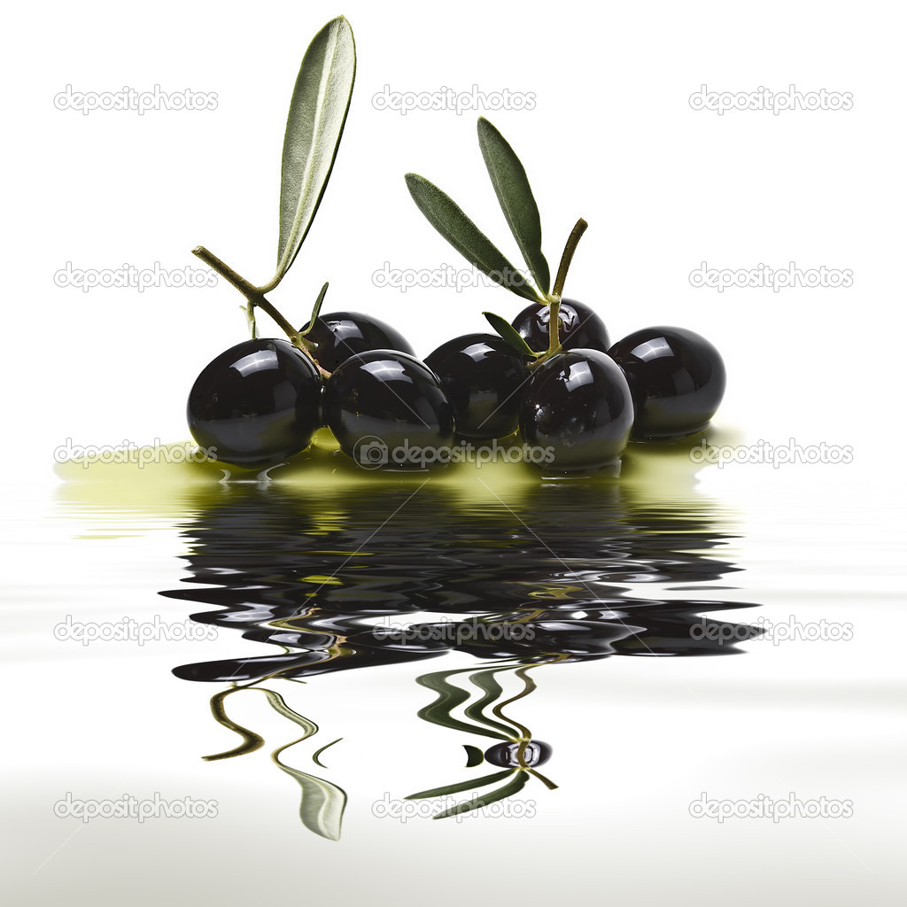 Black olives reflected on water.