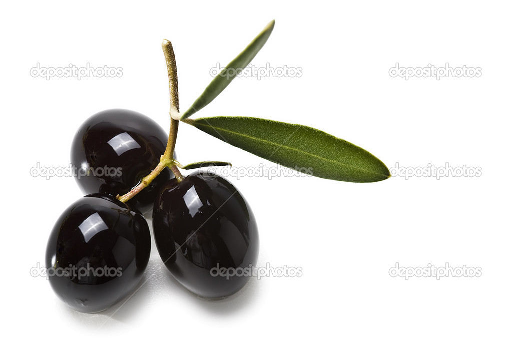Three black olives with leaves.