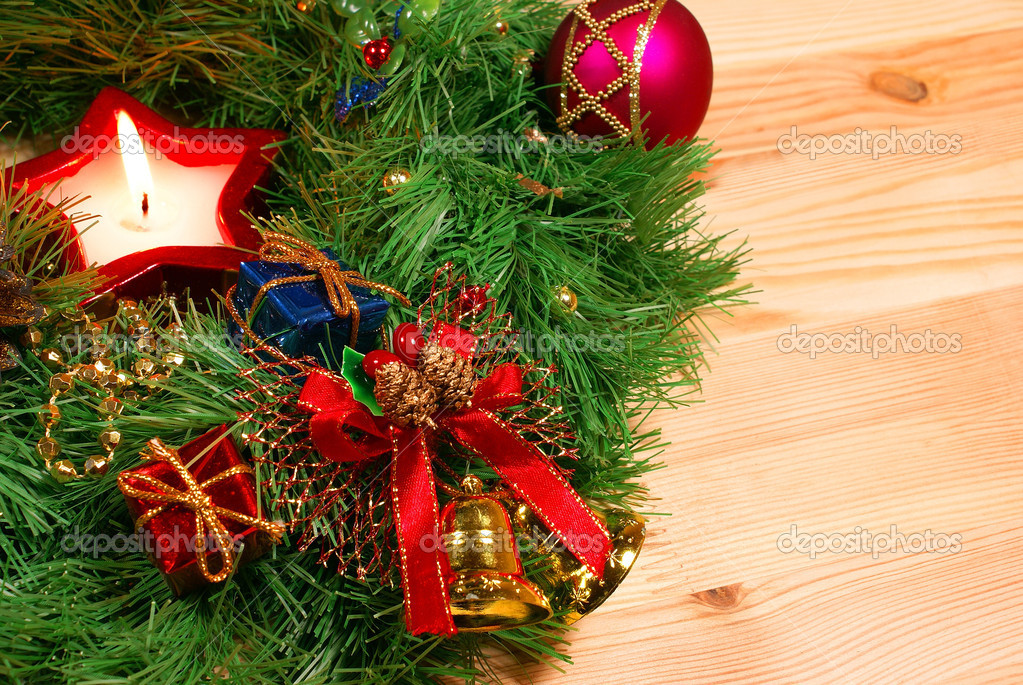 Nice Xmas decorations: red sphere, golden bells with red ribbon, red ...
