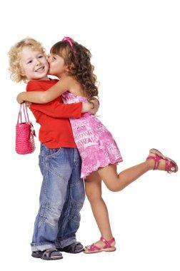 Little girl kissing beautiful little boy