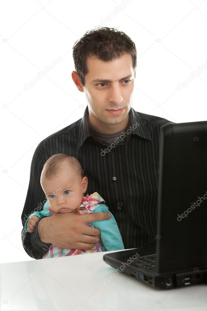 Young father with his daughter working on laptop