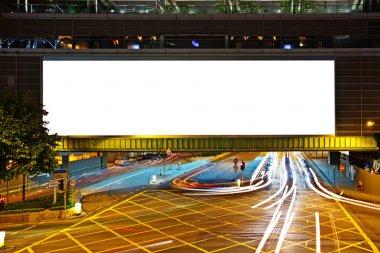 Big empty billboard at night in city