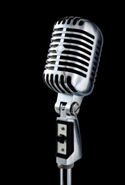 Vintage Microphone Isolated Over Black Background