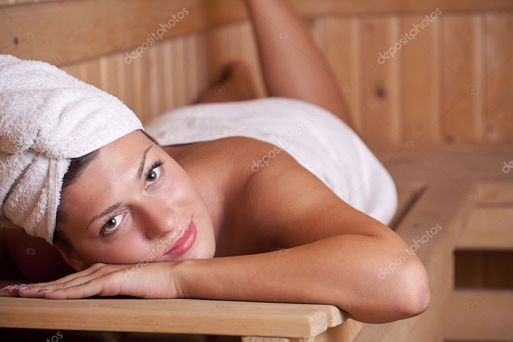 Woman relaxing in the sauna