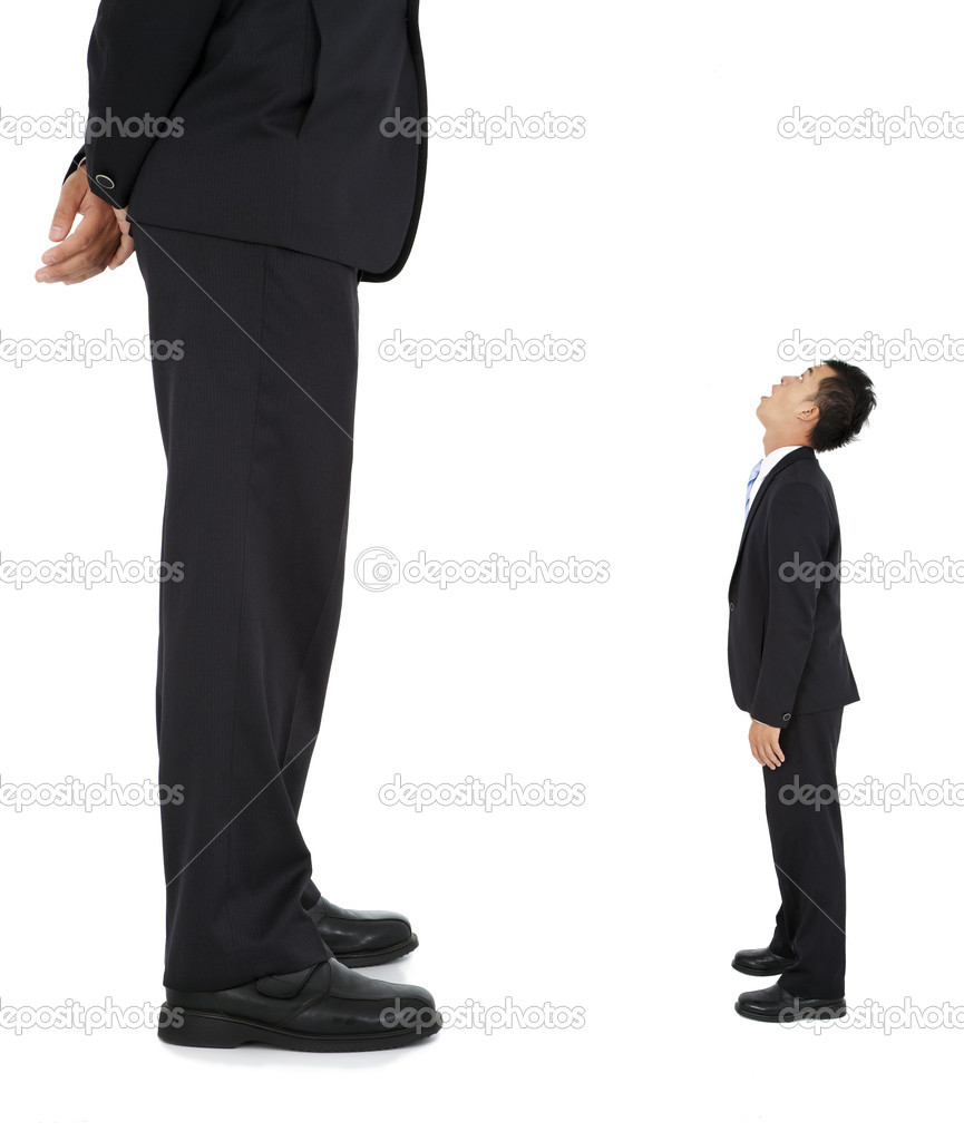 Little businessman looked at a giant businessman