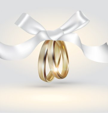 Golden wedding rings with ribbon