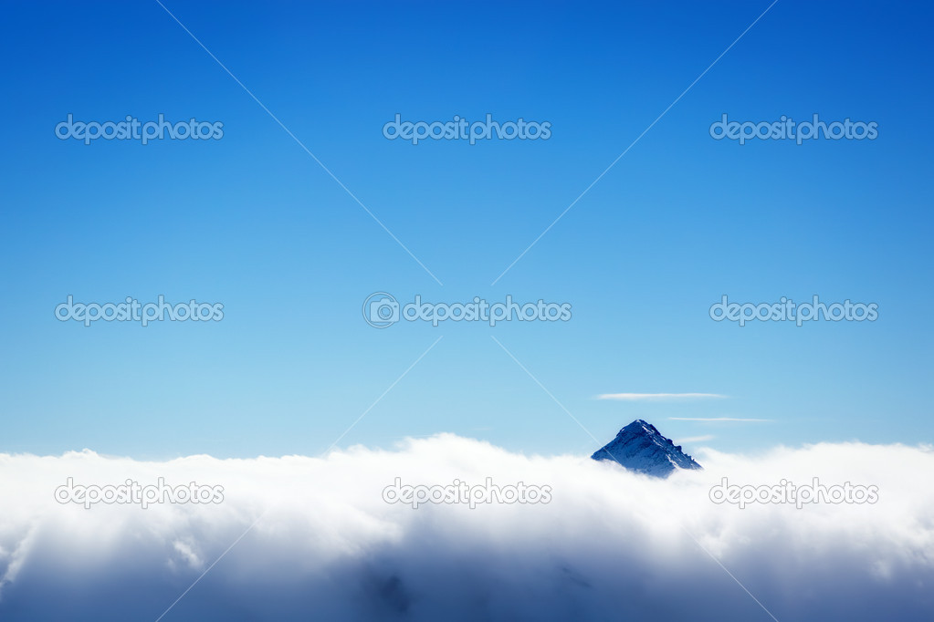 Mountain's top over clouds