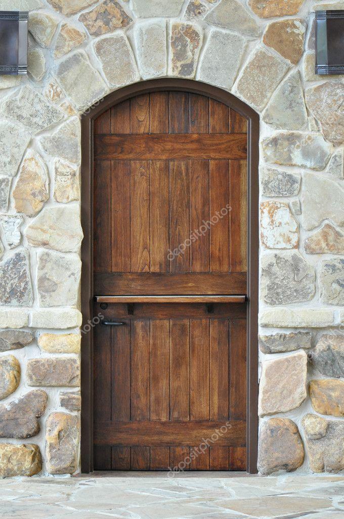 Wooden door on stone wall