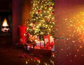 Fényképek karácsonyi jelenet a fa és a tűz, a háttér