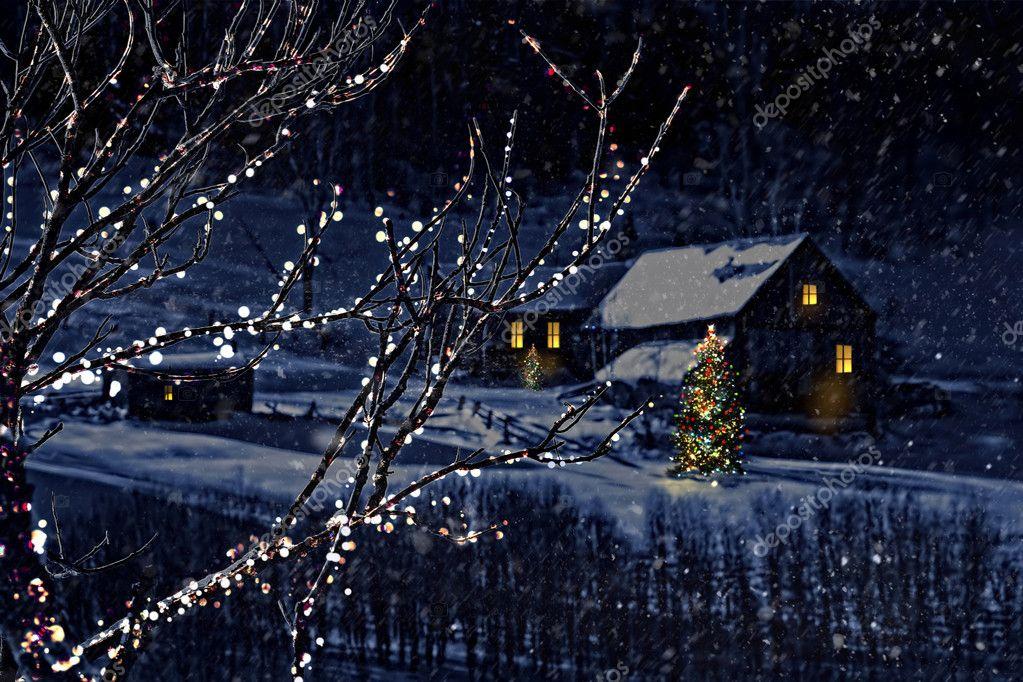 Snowy winter scene of a cabin in distance
