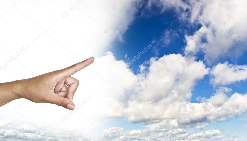 Hand on the blue clear sky