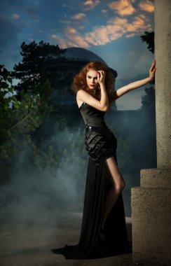 Elegant woman in black dress