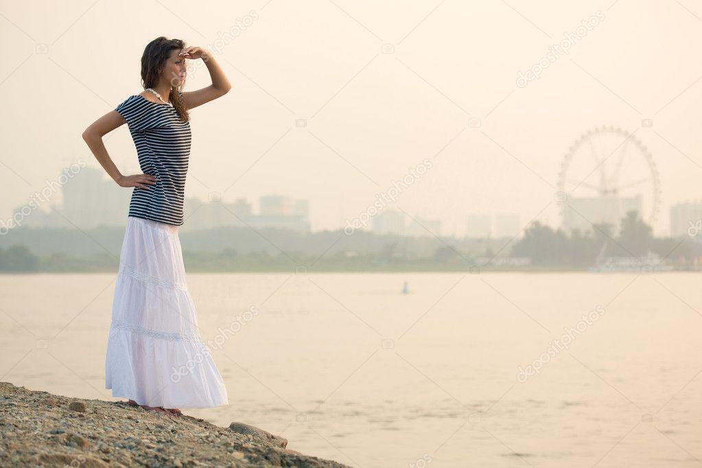 Brunette woman standing on beach