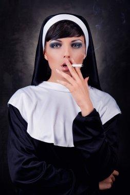Smoking young nun stock vector