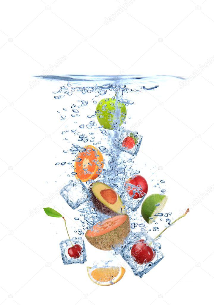 Ice cubes with fruit splashing