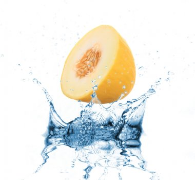 Yellow melon dropped into water splash on white