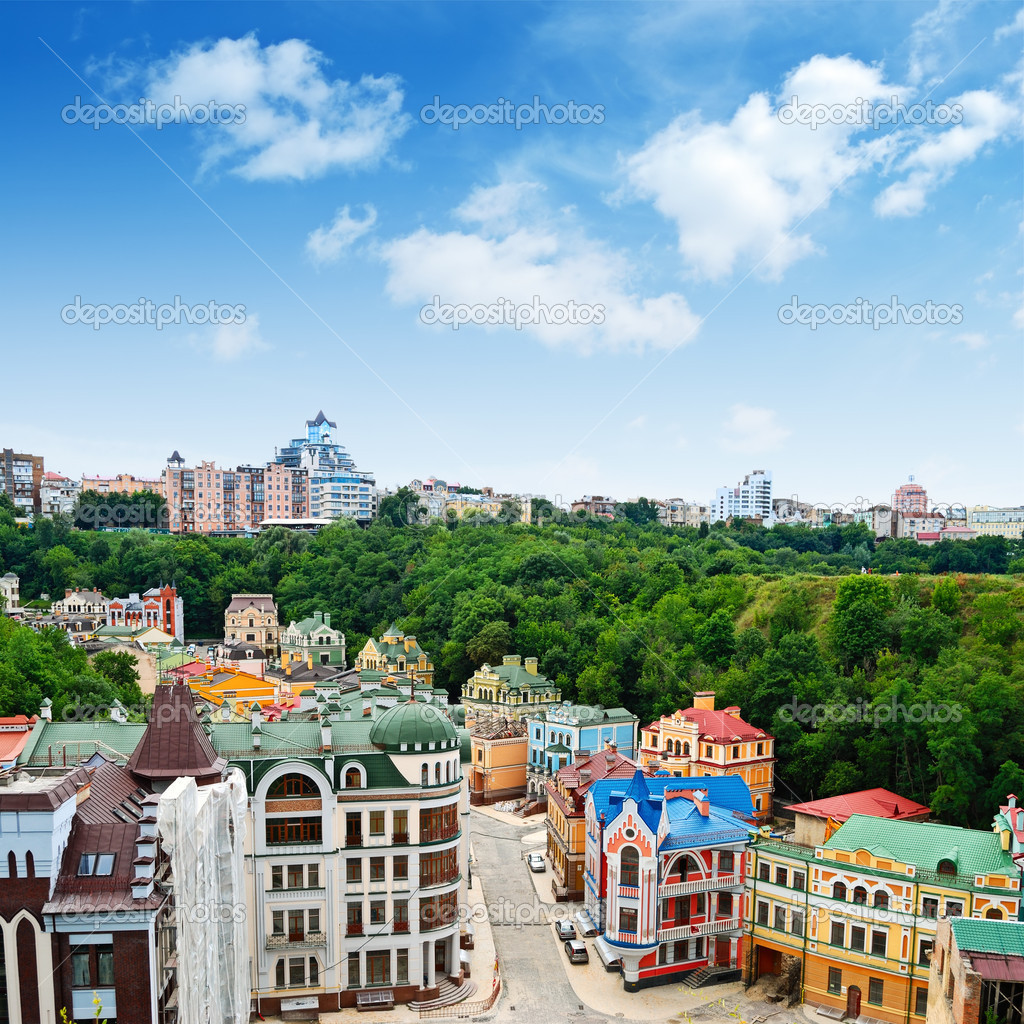 Multicolored houses among the green trees and blue sky — Stock Photo ...