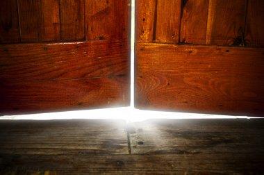 White light under old door