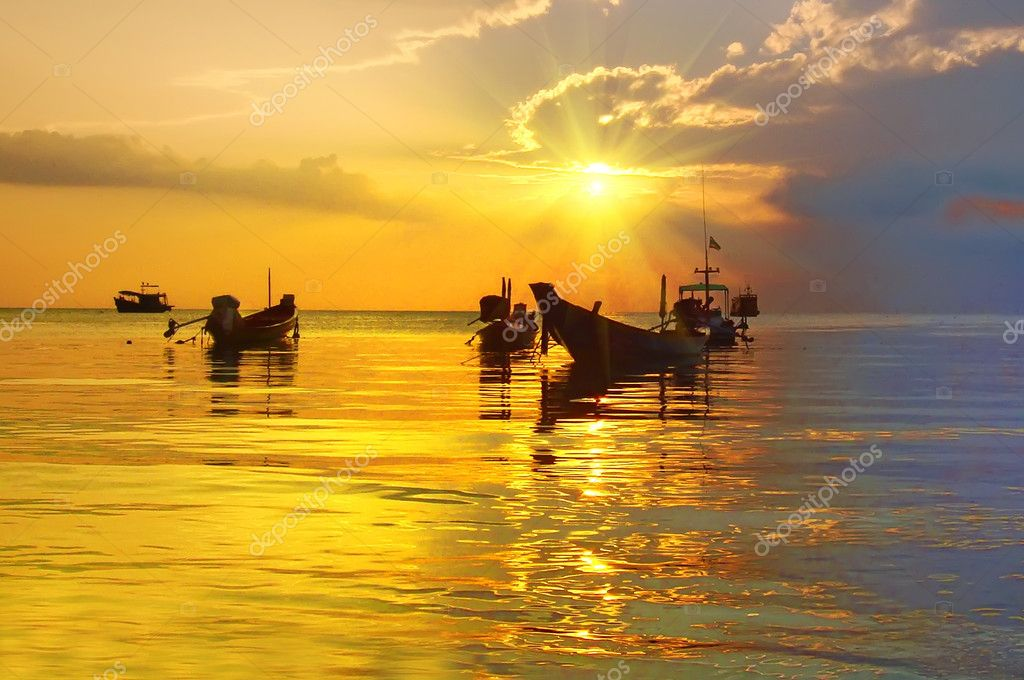 Golden Sunset and longtail boats on tropical beach. Tao island,