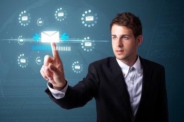 Businessman pressing virtual messaging type of icons