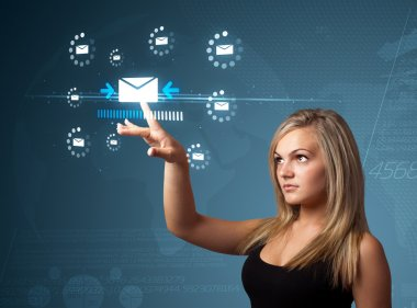 Businesswoman pressing virtual messaging type of icons