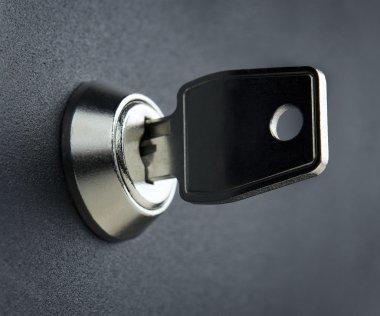 Key in the deposit box keyhole