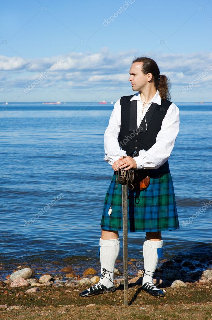 Man in scottish costume with sword