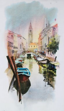 A view of the canal with boats and buildings in Venice