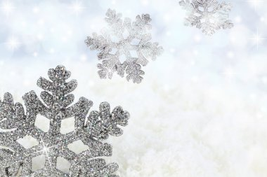 Snowflake on the snow background