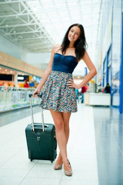 Young woman with luggage at the international airport. She is ve