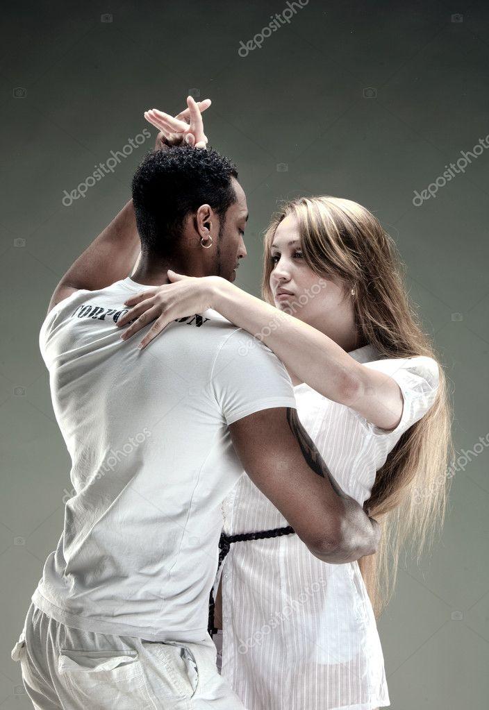 Young couple dances Salsa. Vintage photo.