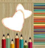 barevné tužky na dřevěném pozadí