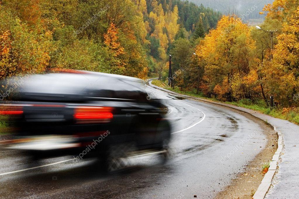 Black car on autumn road