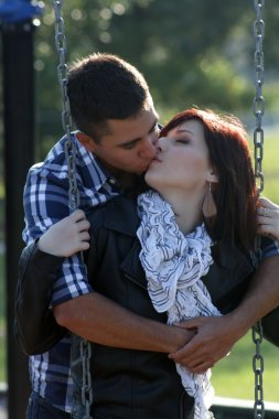 Romantic Couple Kissing on a Playground (2)