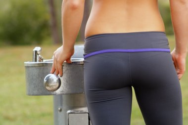 Beautiful Female Athlete at a Water Fountain (2)