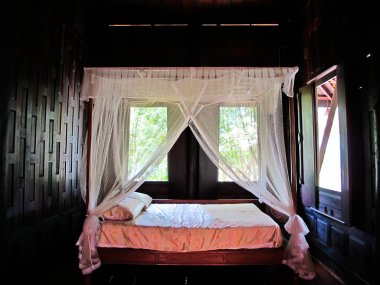 Bed and mattress in a wooden Thai house