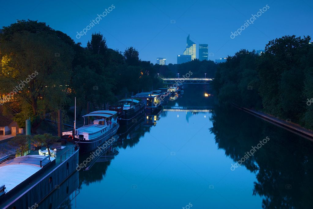 Nightview Of Houseboats On The Seine In Paris Stock Photo