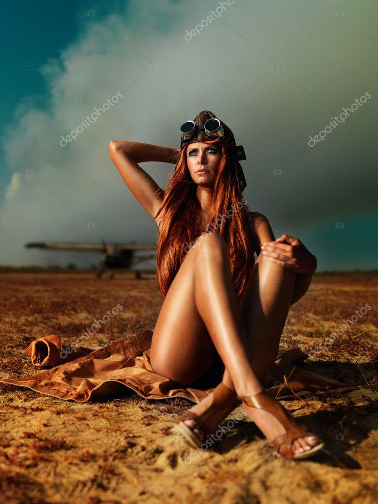Fashionable aviator woman sitting smokey plane