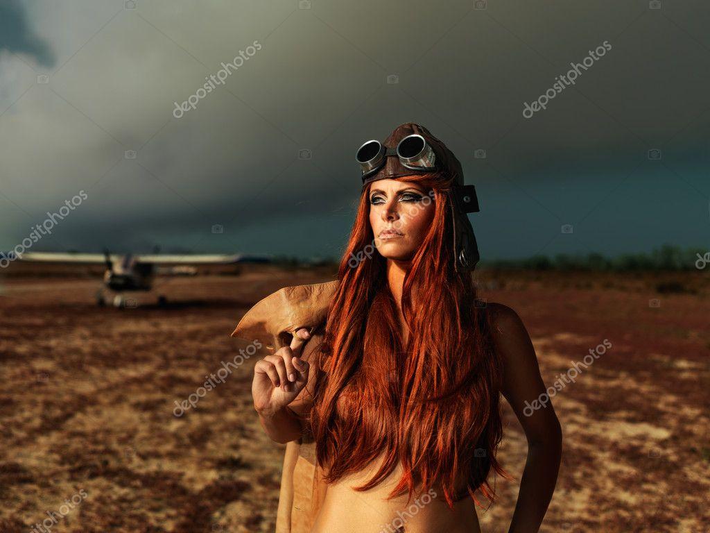 Fashionable aviator woman with smokey plane
