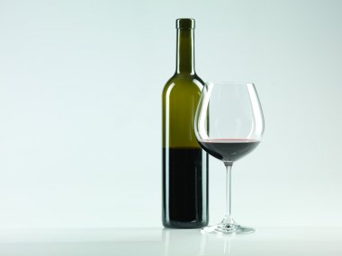 Bottle of wine, glass with red wine